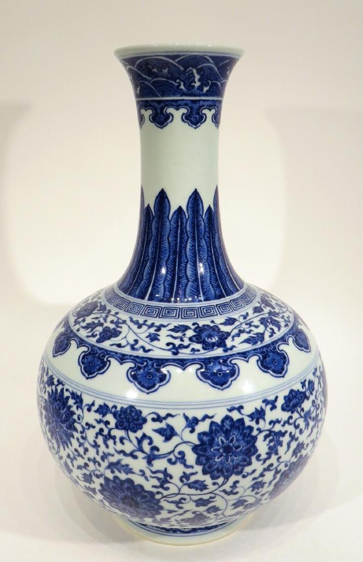 QIAN LONG MARKED BLUE AND WHITE PORCELAIN VASE