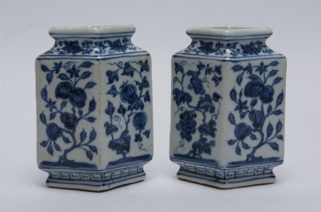 TWO BLUE AND WHITE RHOMBOID BUD VASES