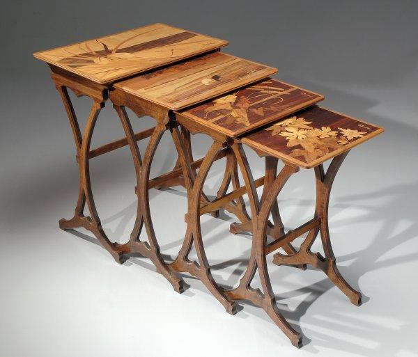 13: ÉMILE GALLÉ (1846-1904)  Set of four walnut table n