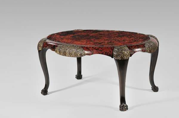 52: MAISON FRANCK FRÈRES Oval coffee table in tinted ma