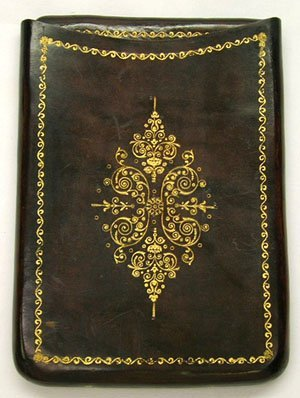 20: EARLY HAND TOOLED GOLD ON LEATHER CIGARETTE CASE