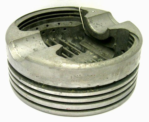 668: WWII TRENCH ART ASHTRAY MADE FROM JAP ZERO PISTON