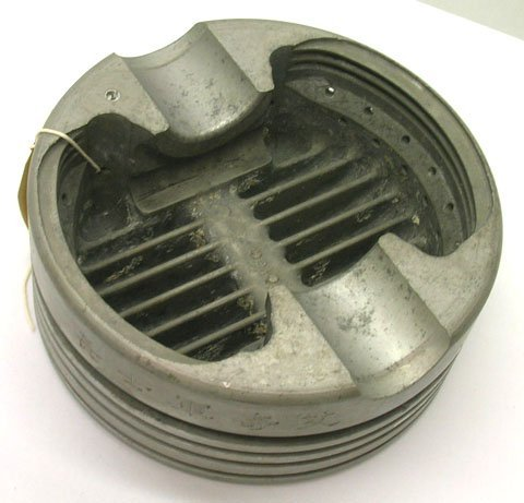 668: WWII TRENCH ART ASHTRAY MADE FROM JAP ZERO PISTON - 2