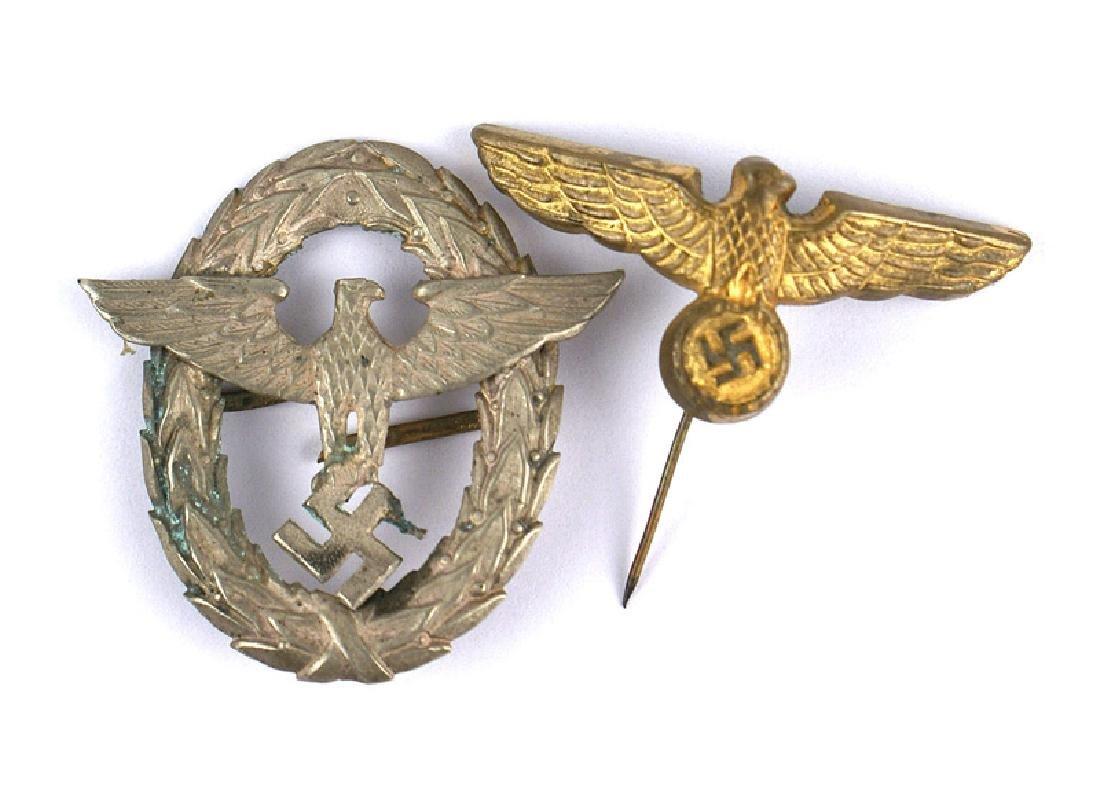 Lot of 2 German WWII metal cap insignia
