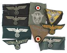 Lot of 9 German WWII cap insignia