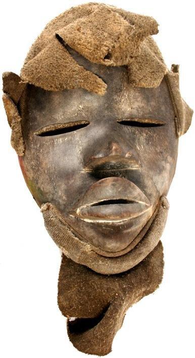 21: African Dan wood mask Circa 1900.