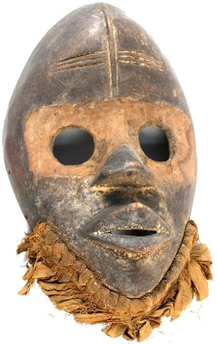 22: African Dan ceremonial wood mask 1900