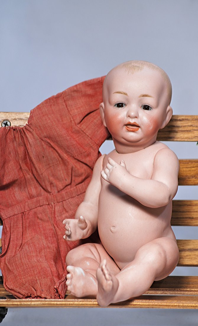 *11. GERMAN ALL-BISQUE SOLID-DOMED CHARACTER BABY BY
