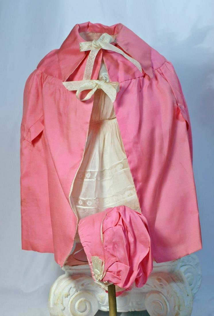 *31. DOLL'S PINK SILK CAPE WITH MATCHING BONNET.