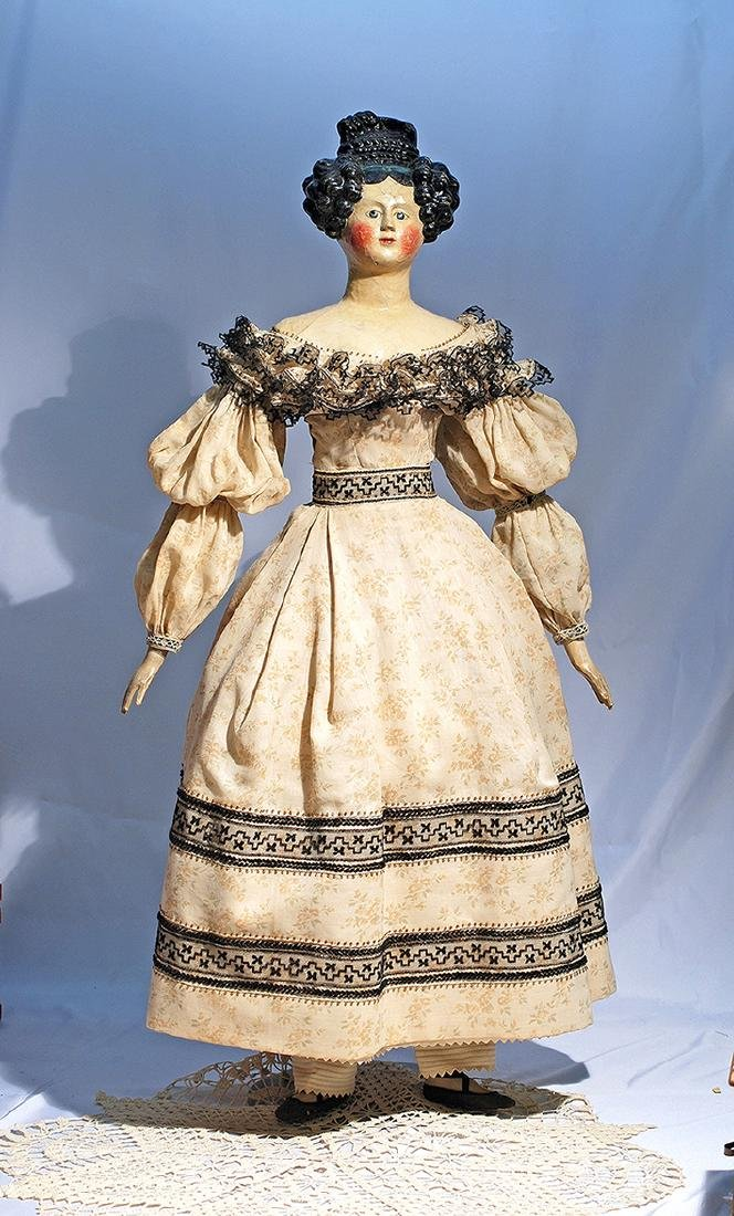 72.  LARGE EARLY GERMAN PAPER MACHE LADY WITH ELABORATE
