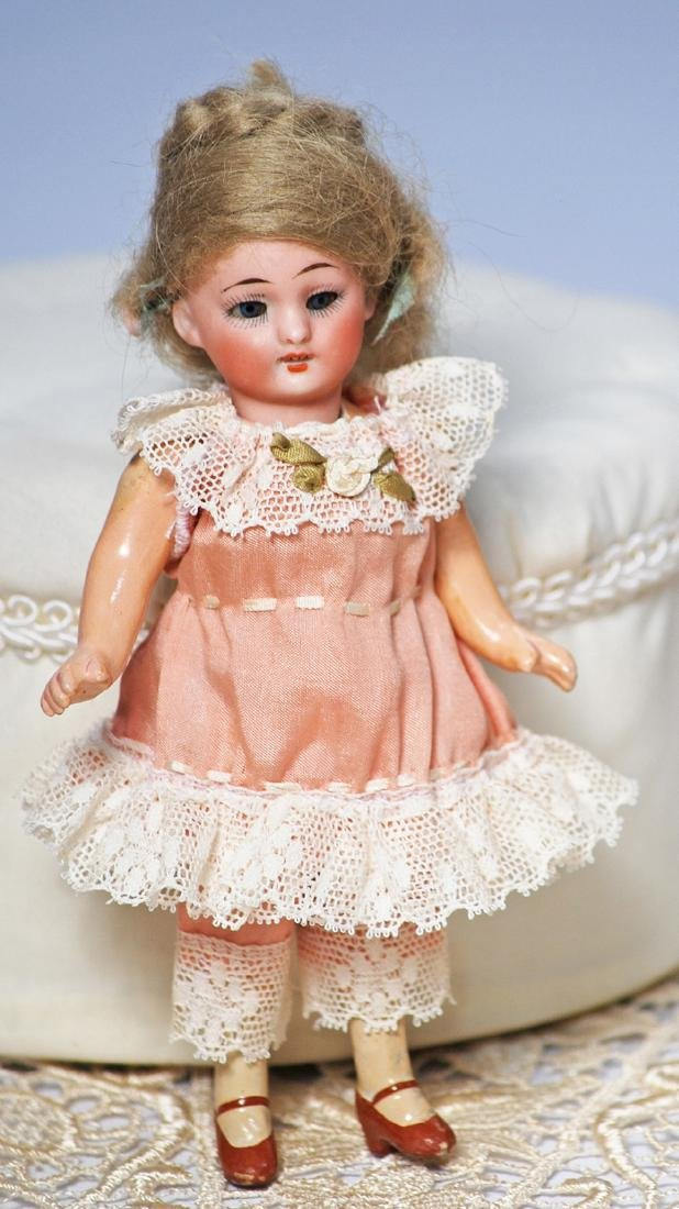 *106-A.  MINIATURE GERMAN BISQUE DOLL.  Marks: None.  5