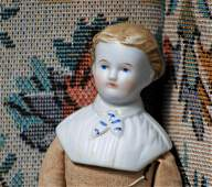 134. SMALL GERMAN BISQUE GENTLEMAN WITH SCULPTED