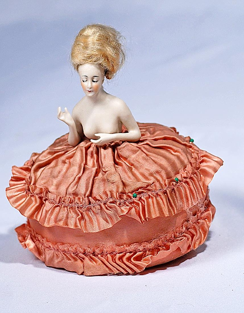 172.  GERMAN BISQUE PINCUSHION HALF DOLL WITH ARMS