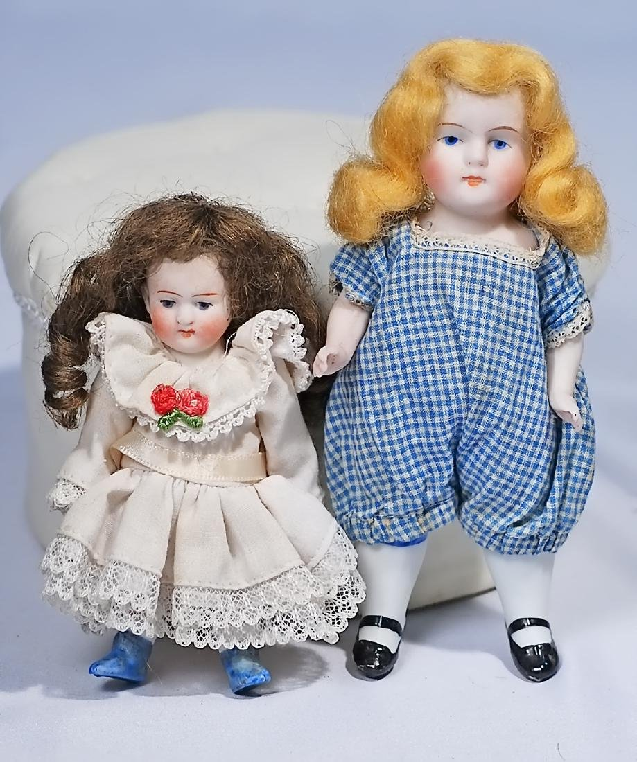 """173.  TWO GERMAN ALL-BISQUE DOLLS. 4"""" doll marked 520;"""