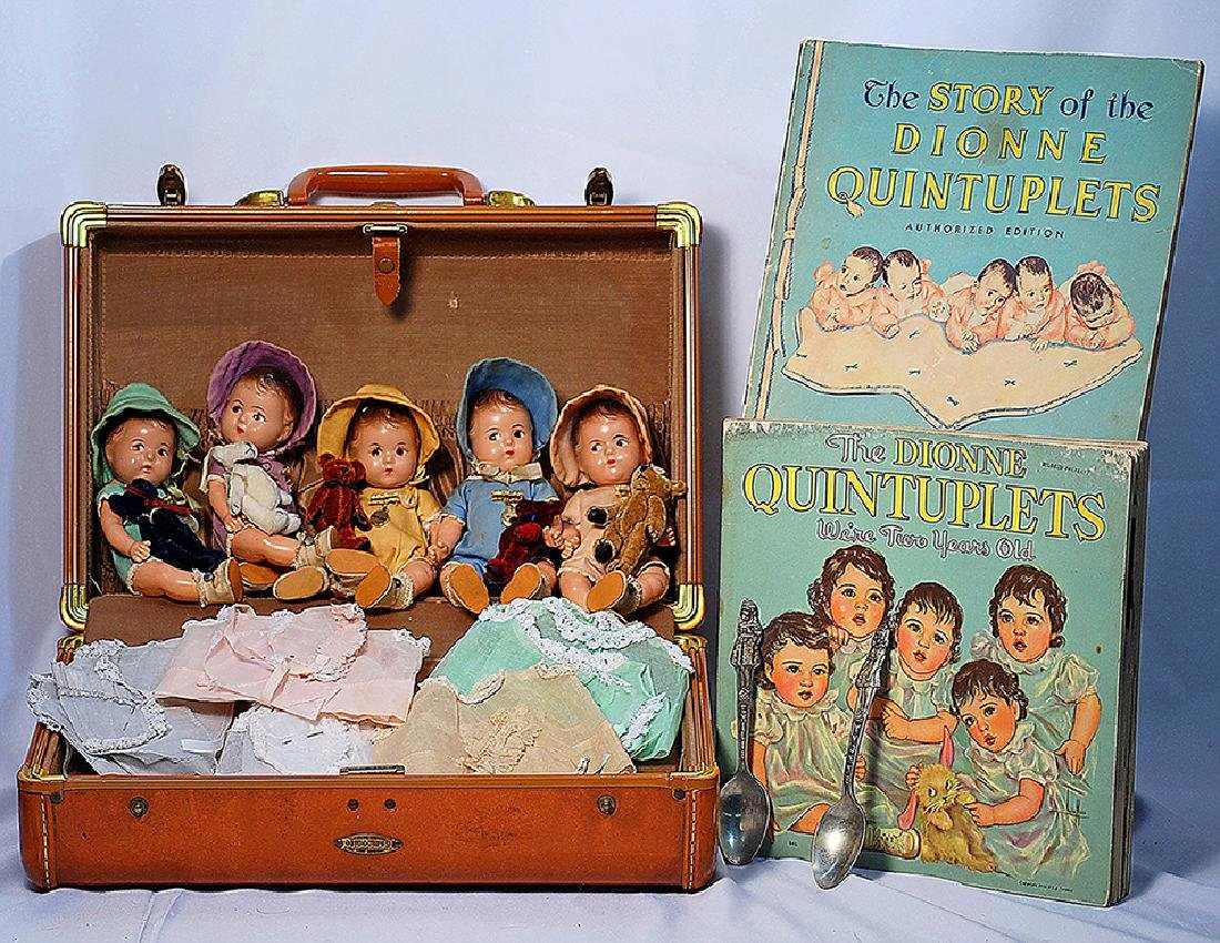 223.  SET OF COMPOSITION DIONNE QUINTUPLETS IN SUITCASE