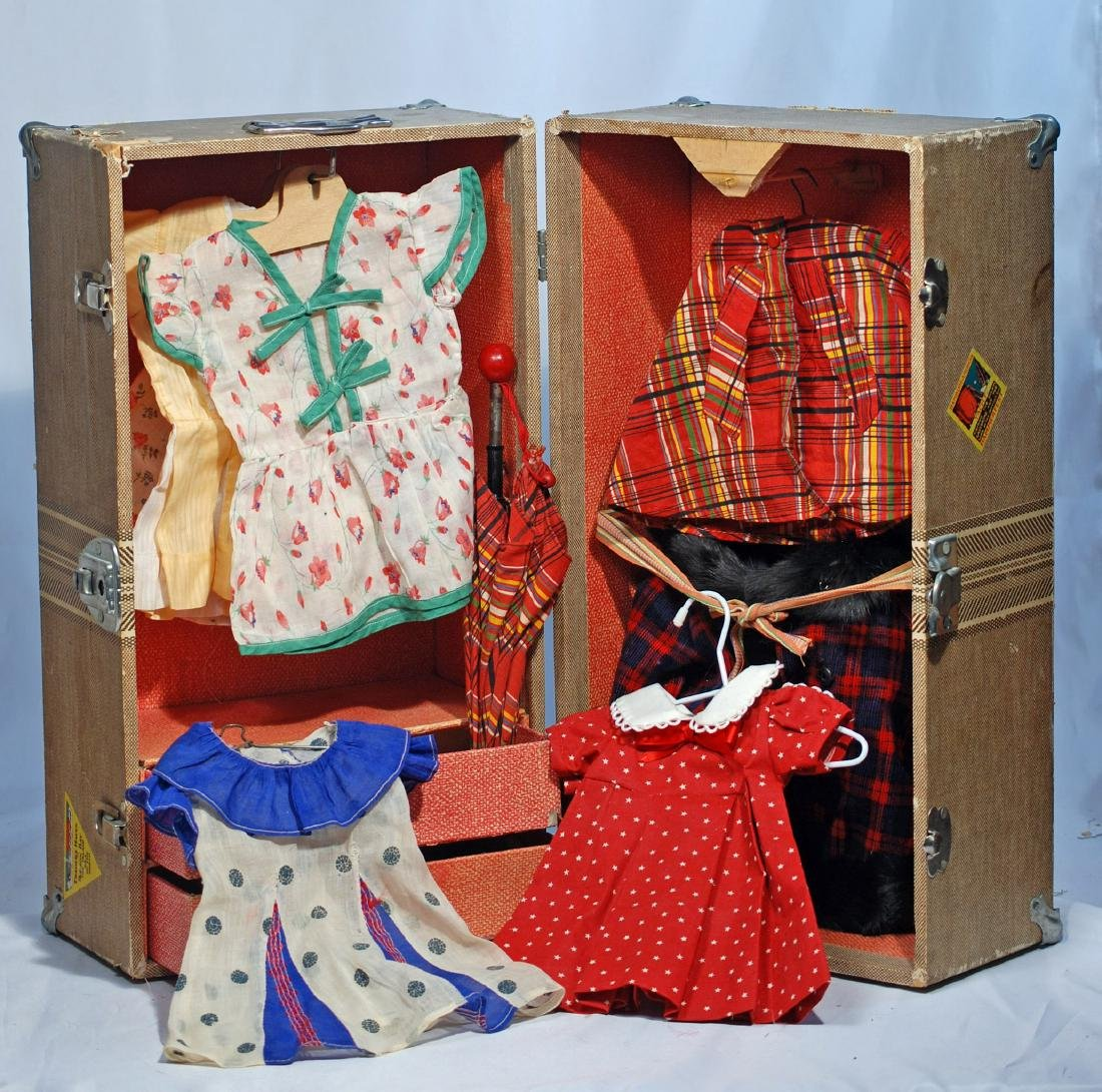 """257.  SHIRLEY TEMPLE DOLL TRUNK AND CLOTHES.  18"""" x 10"""""""