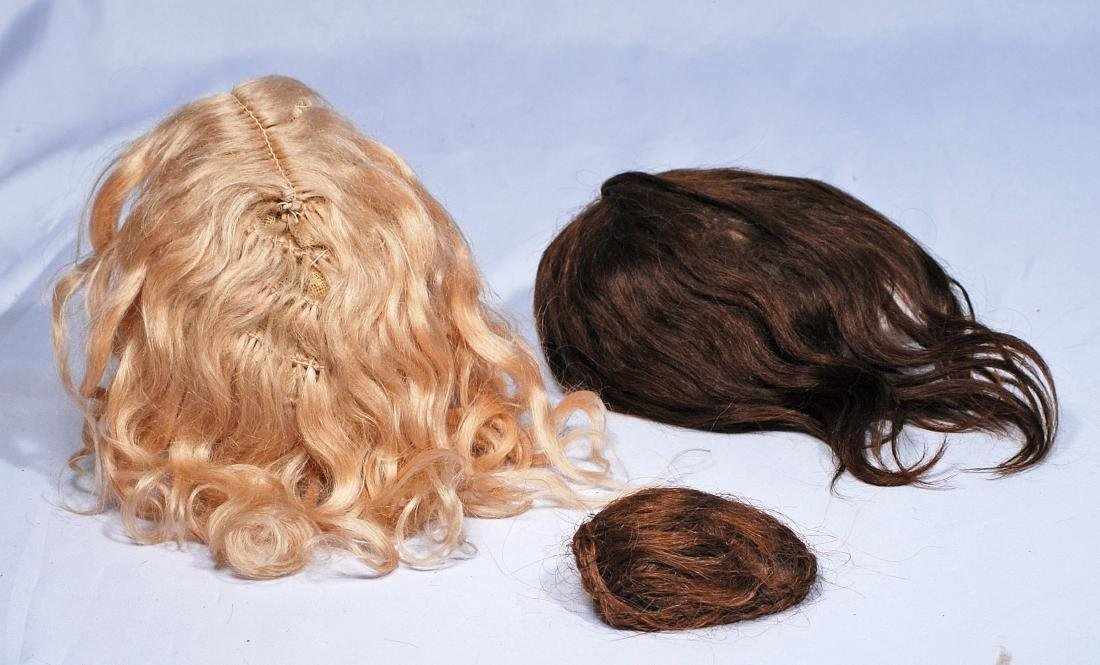 263.  THREE ANTIQUE DOLL WIGS.  Blonde mohair with