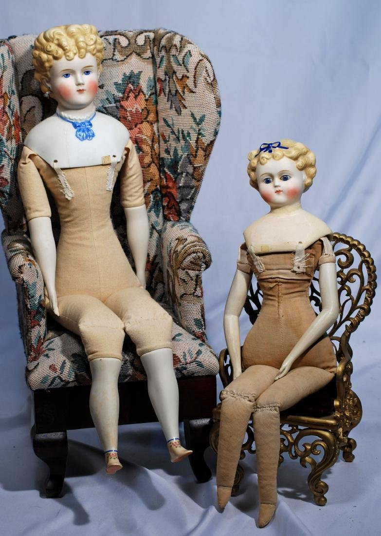 266. TWO PARIAN DOLLS WITH MENDED SHOULDERS.  Each has