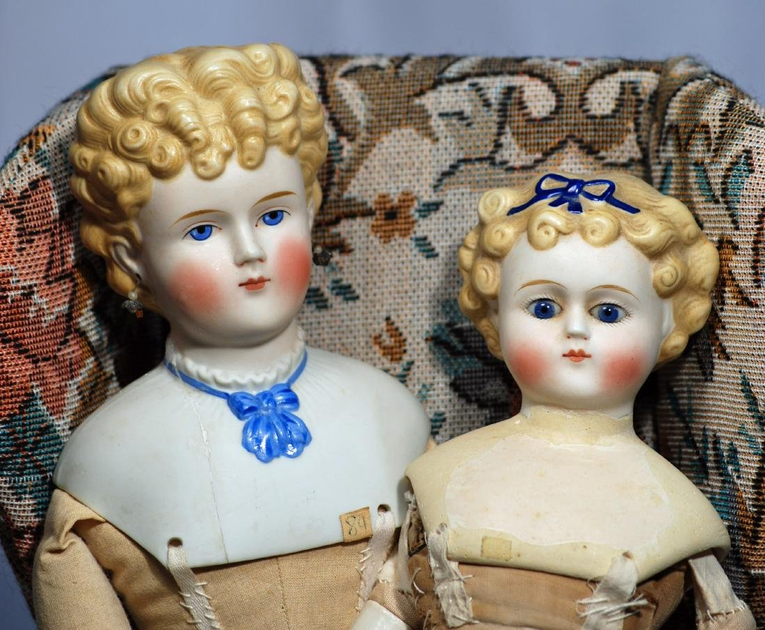 266. TWO PARIAN DOLLS WITH MENDED SHOULDERS.  Each has - 2