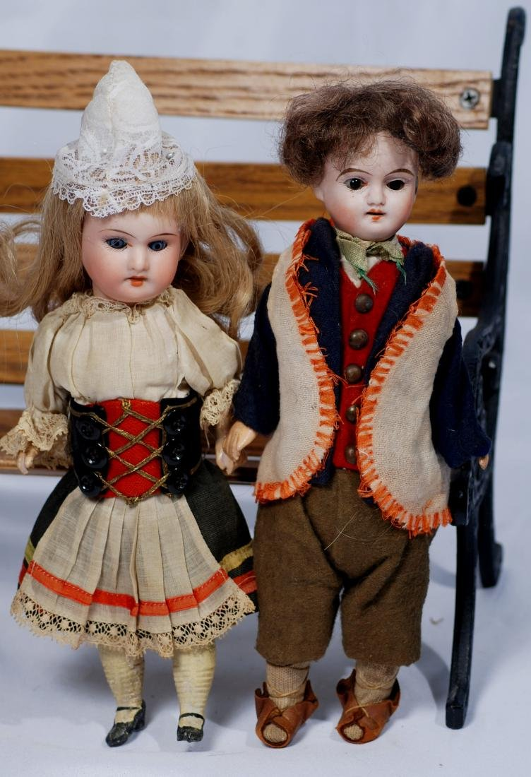 """272.  TWO SMALL GERMAN BISQUE DOLLS.  9"""" boy and 8 ½"""""""