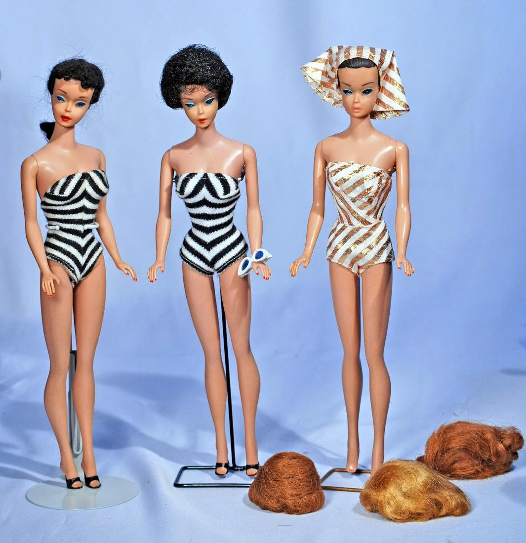 282.  THREE BARBIE DOLLS.  Barbie #4 with black