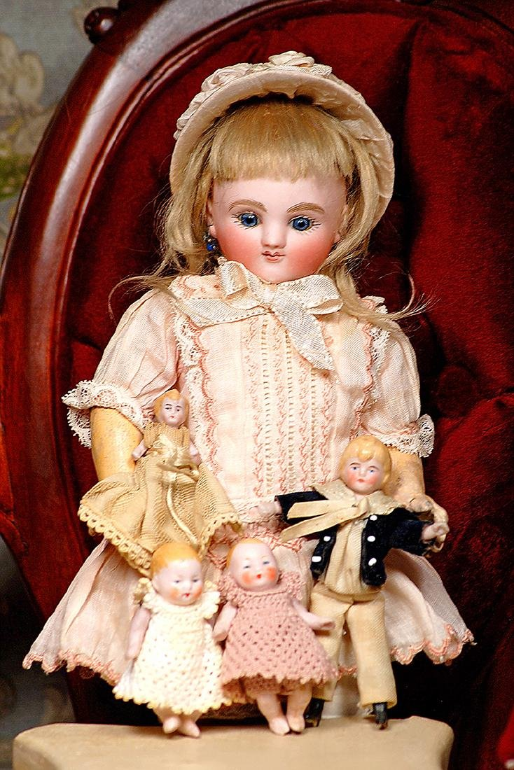 FOUR MINIATURE BISQUE DOLLS Includes: Two all-bisque 2