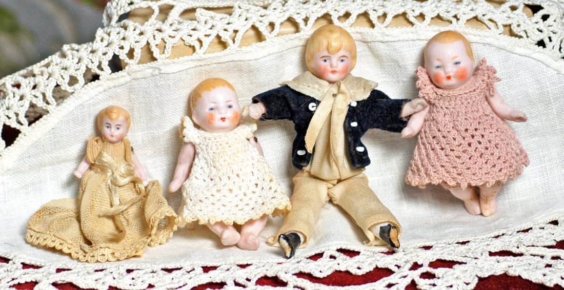 FOUR MINIATURE BISQUE DOLLS Includes: Two all-bisque 2 - 2