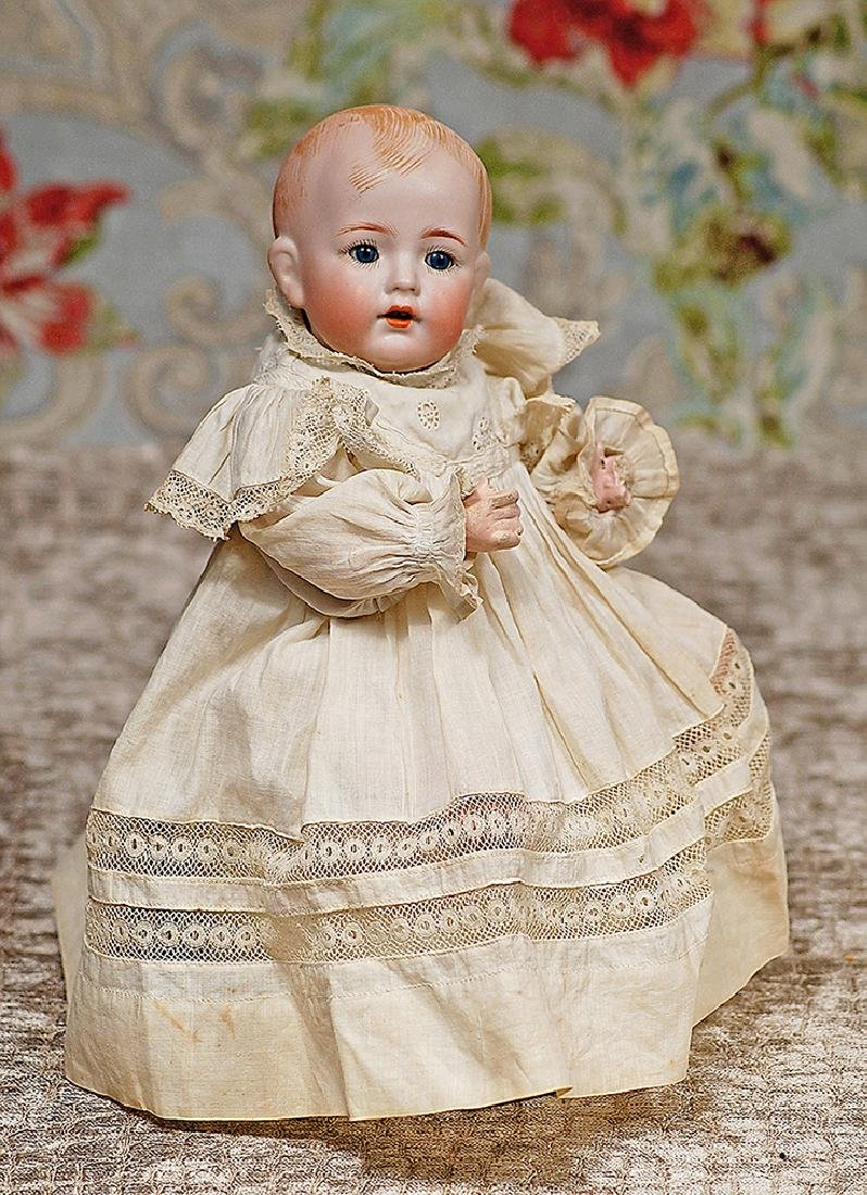 TINY GERMAN BISQUE CHARACTER, 127, BY KAMMER AND