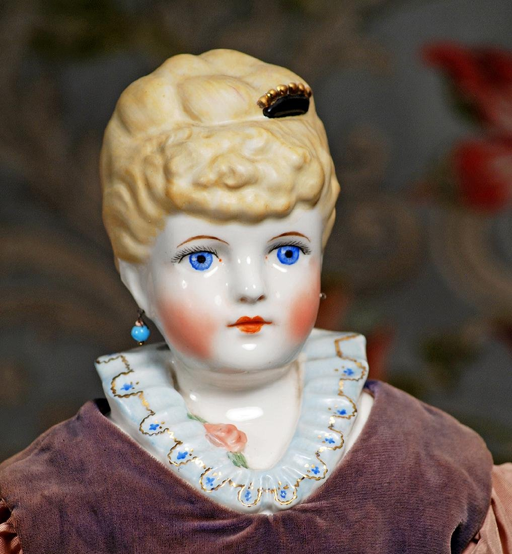 PORCELAIN DOLL WITH FANCY HAIR AND BODICE BY EMMA CLEAR