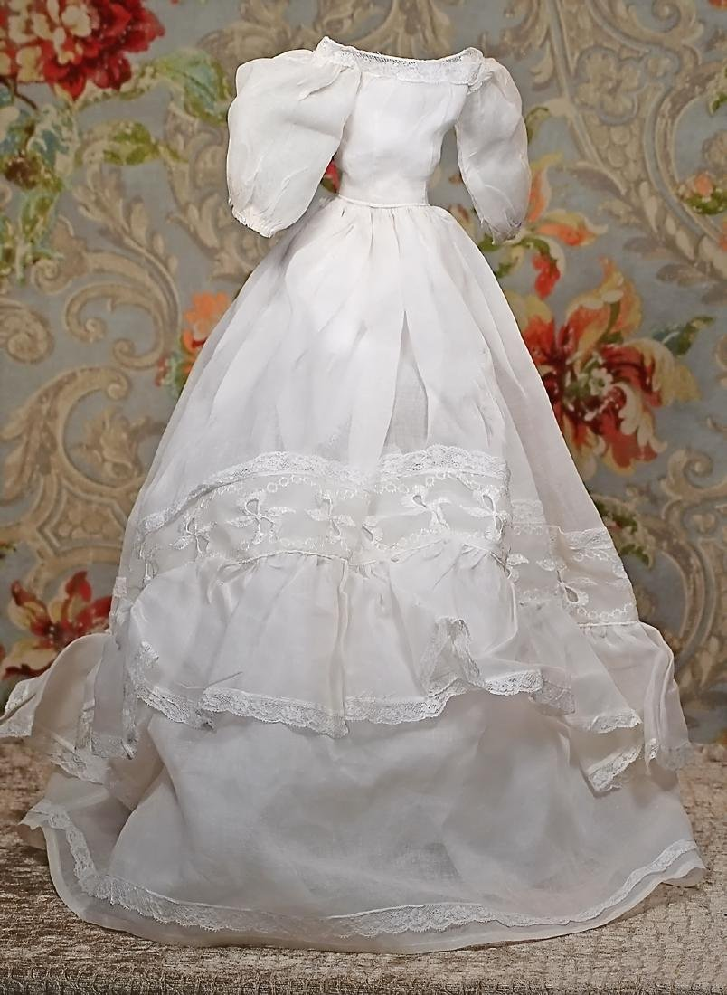 WHITE ORGANDY DOLL GOWN. White organdy made up in gown