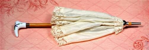 "SILK PARASOL WITH PORCELAIN GRIP 9 ½"" L Cream silk with"