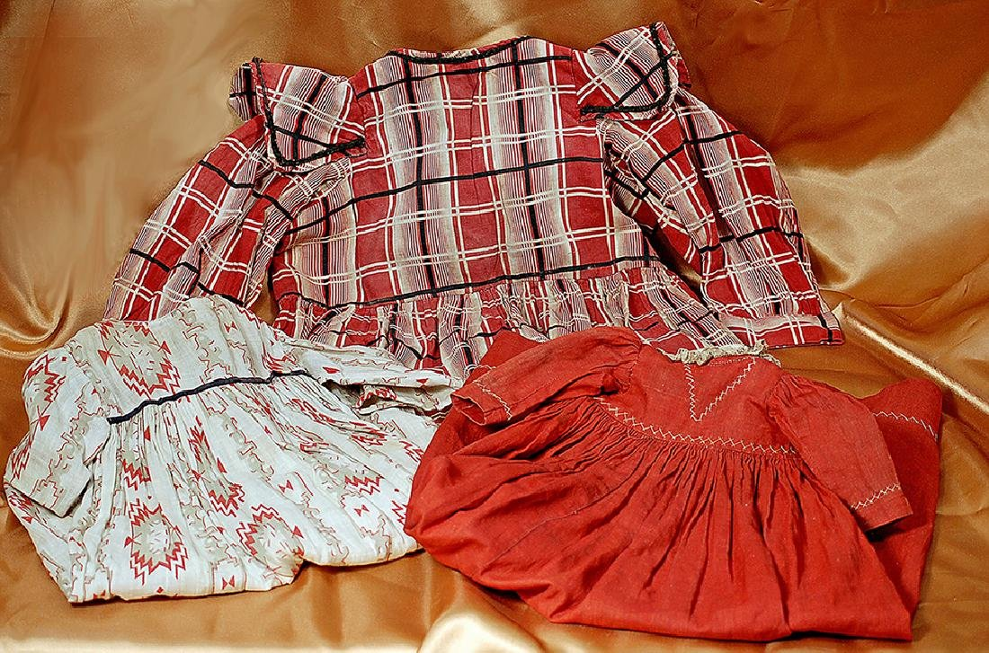 THREE ANTIQUE COTTON DRESSES FOR DOLLS (1) Red and