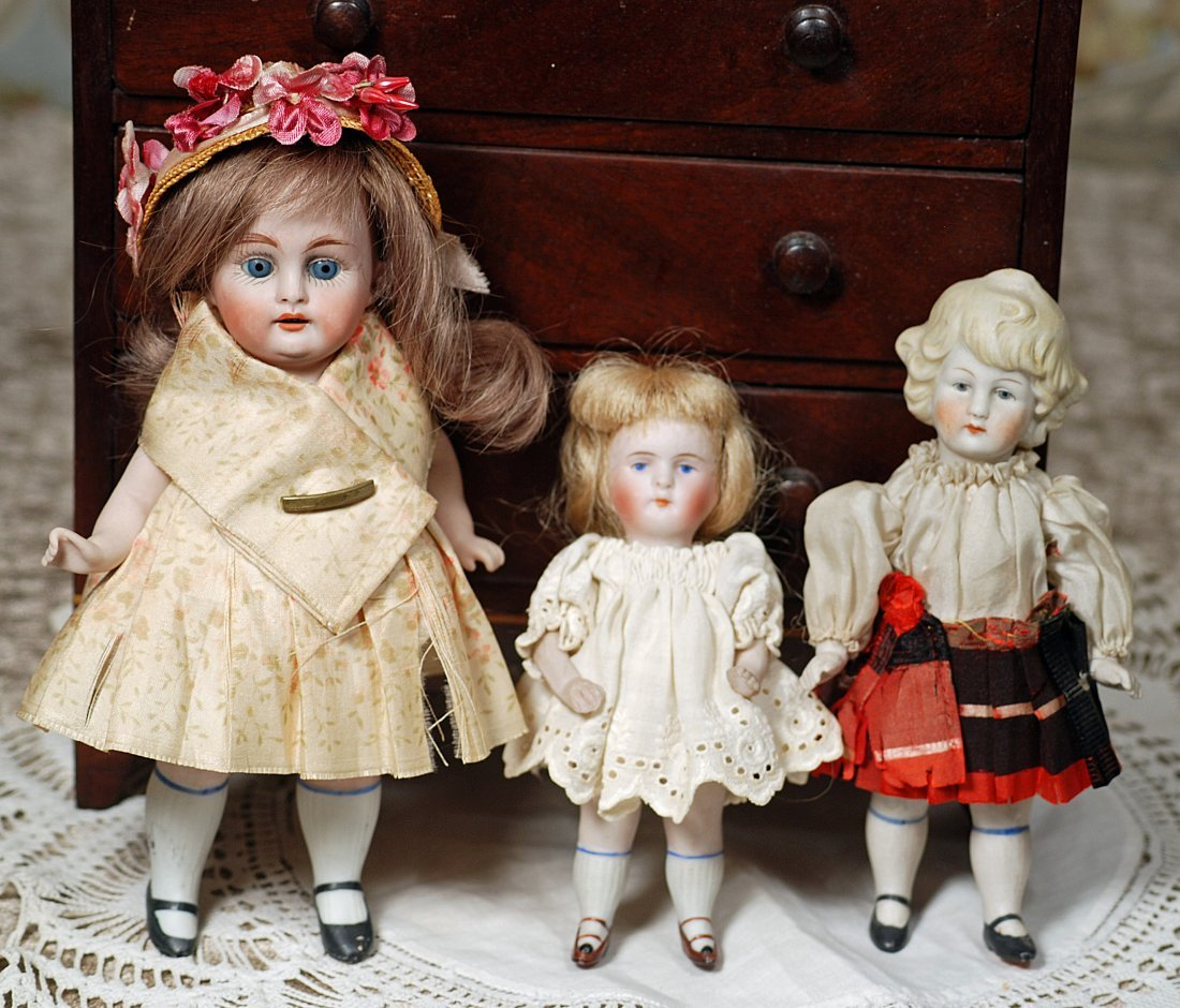 THREE GERMAN ALL-BISQUE DOLLS.