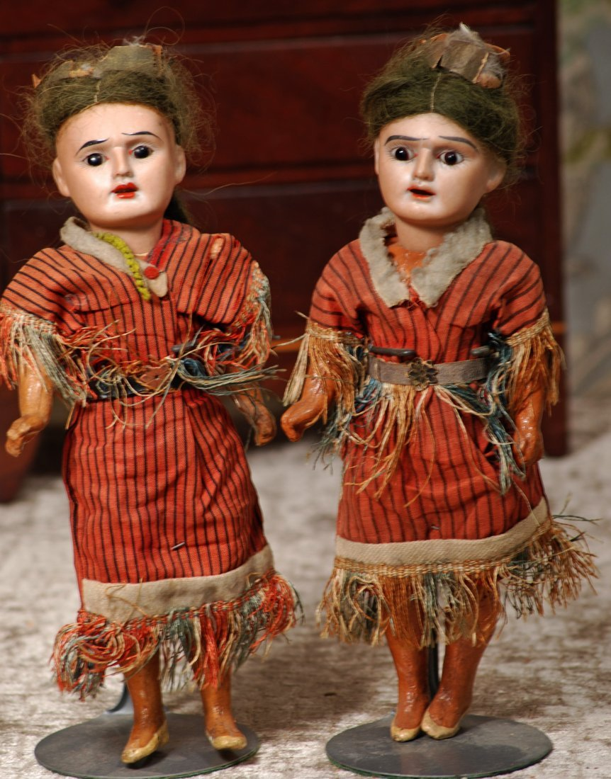 TWO GERMAN BISQUE NATIVE AMERICAN DOLLS.