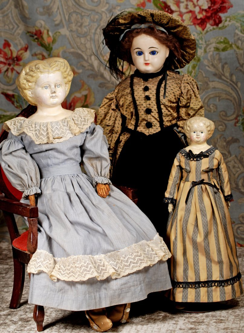 TWO GERMAN PAPER MACHE DOLLS & GLASS-EYED WAX-OVER DOLL