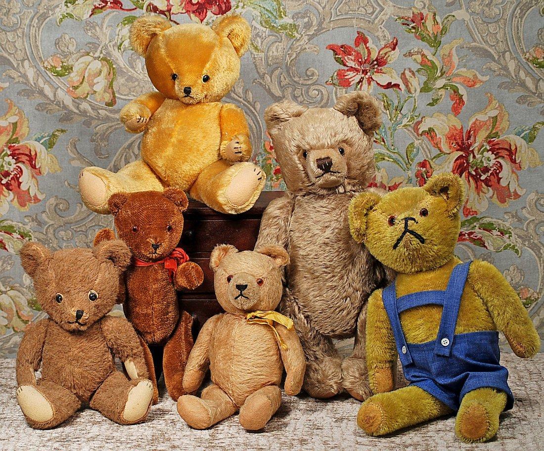 SIX TEDDY BEARS