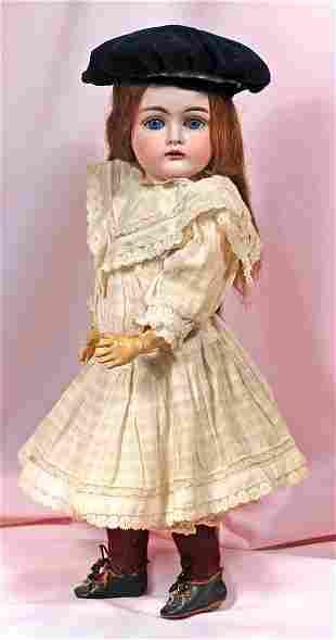 . GERMAN BISQUE CHILD DOLL BY KESTNER. Marks: E. Made