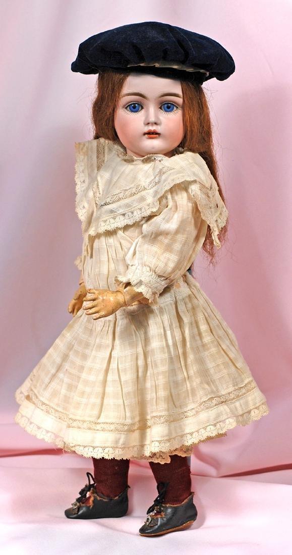 11. GERMAN BISQUE CHILD DOLL BY KESTNER. Marks: E. Made