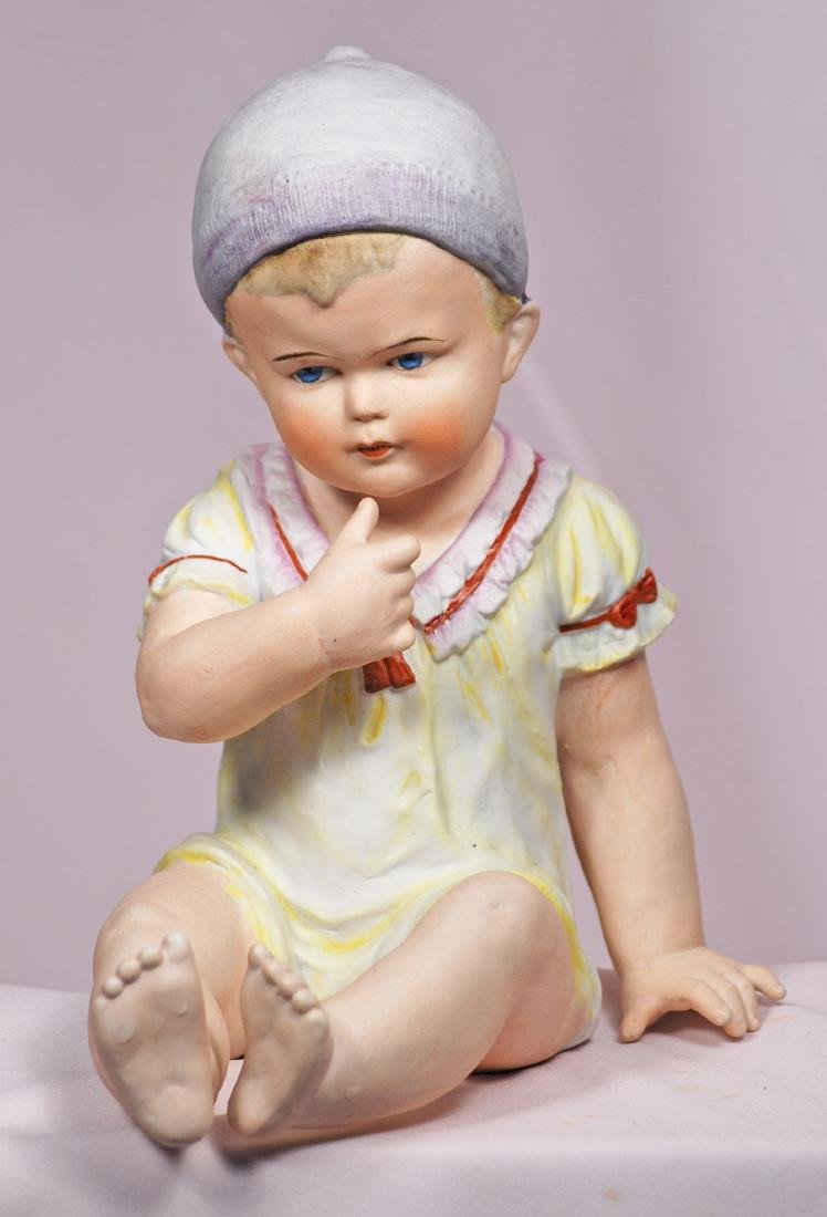 """48. GERMAN BISQUE PIANO BABY. Marks: Germany 9"""". 5078 9 - 2"""