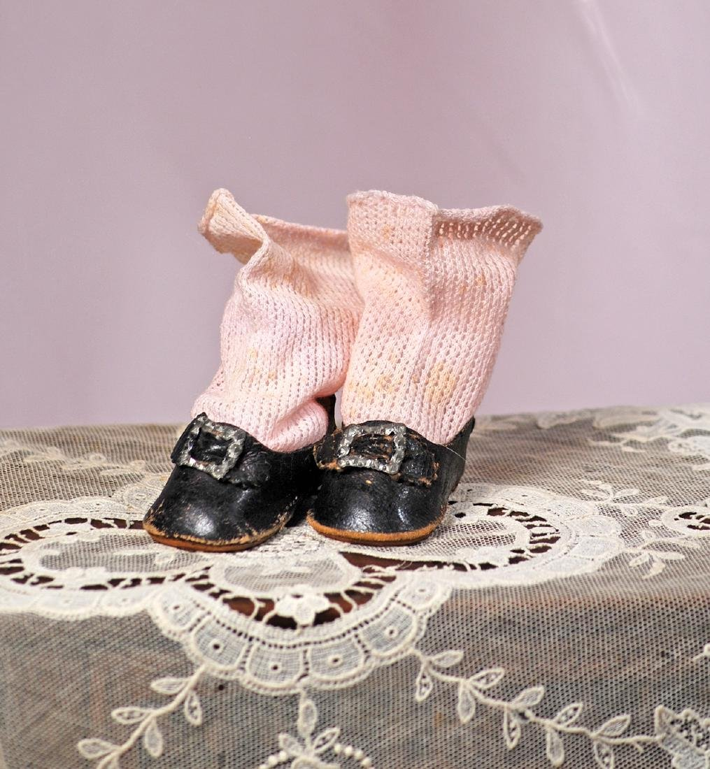 "54. PAIR OF ANTIQUE DOLL SHOES AND SOCKS. 2 1/2"" L."