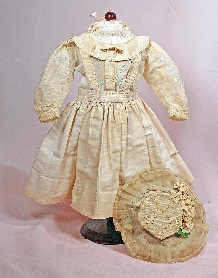 56. DOLL'S PINAFORE, BLOUSE AND BONNET. Ivory cotton