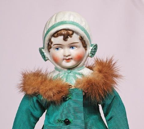 57. GERMAN BISQUE DOLL WITH SCULPTED BONNET AND GOOGLY