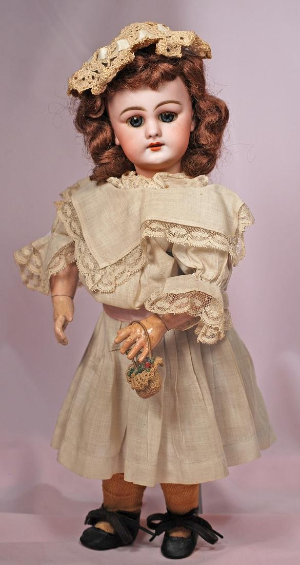 "63. GERMAN BISQUE ""DEP"" DOLL FOR THE FRENCH MARKET."