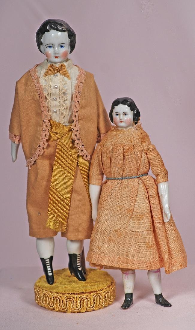 "77. TWO GERMAN PORCELAIN DOLLHOUSE DOLLS. 7 1/2"" and"