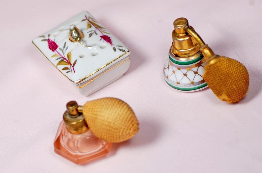 85. TWO MINIATURE PERFUME ATOMIZER BOTTLES AND