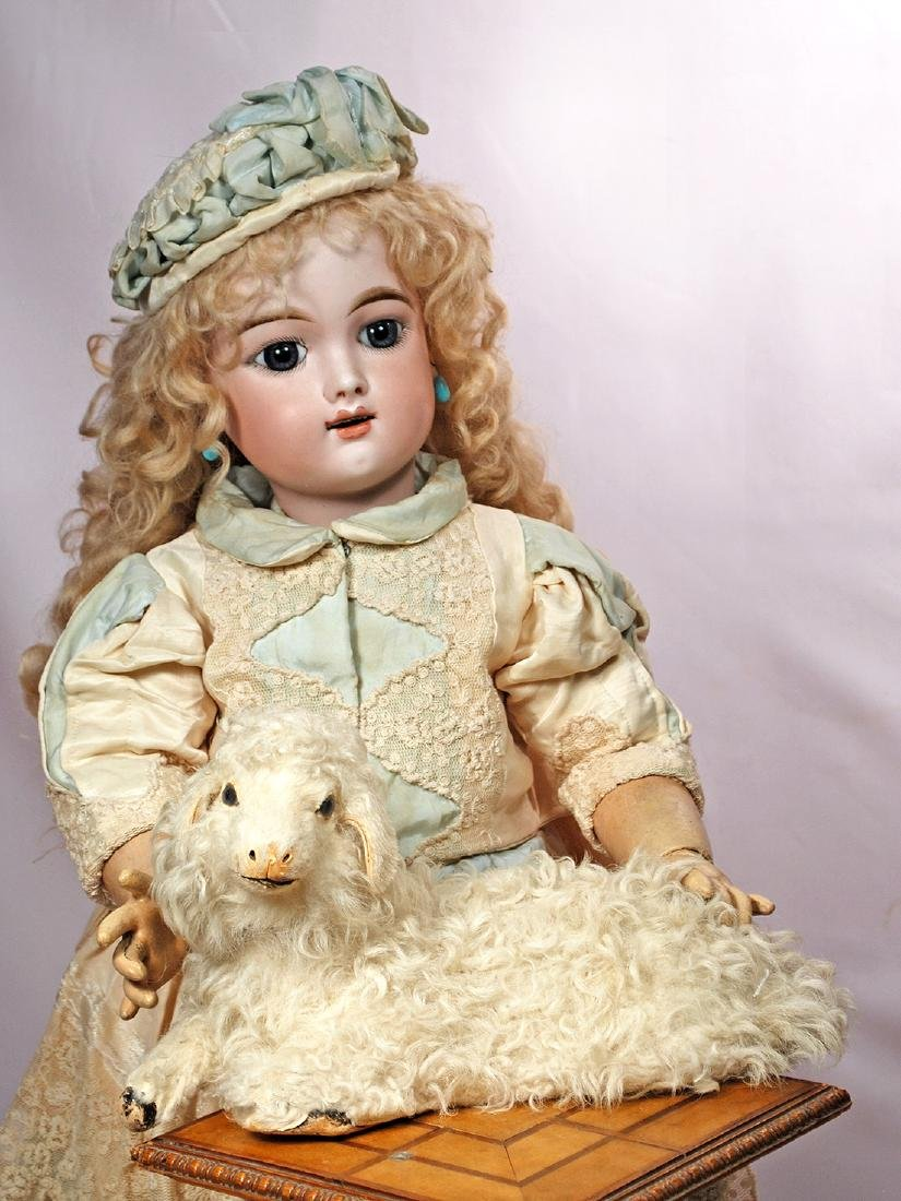 91. WOOLLY LAMB CANDY CONTAINER. Paper mache lamb with
