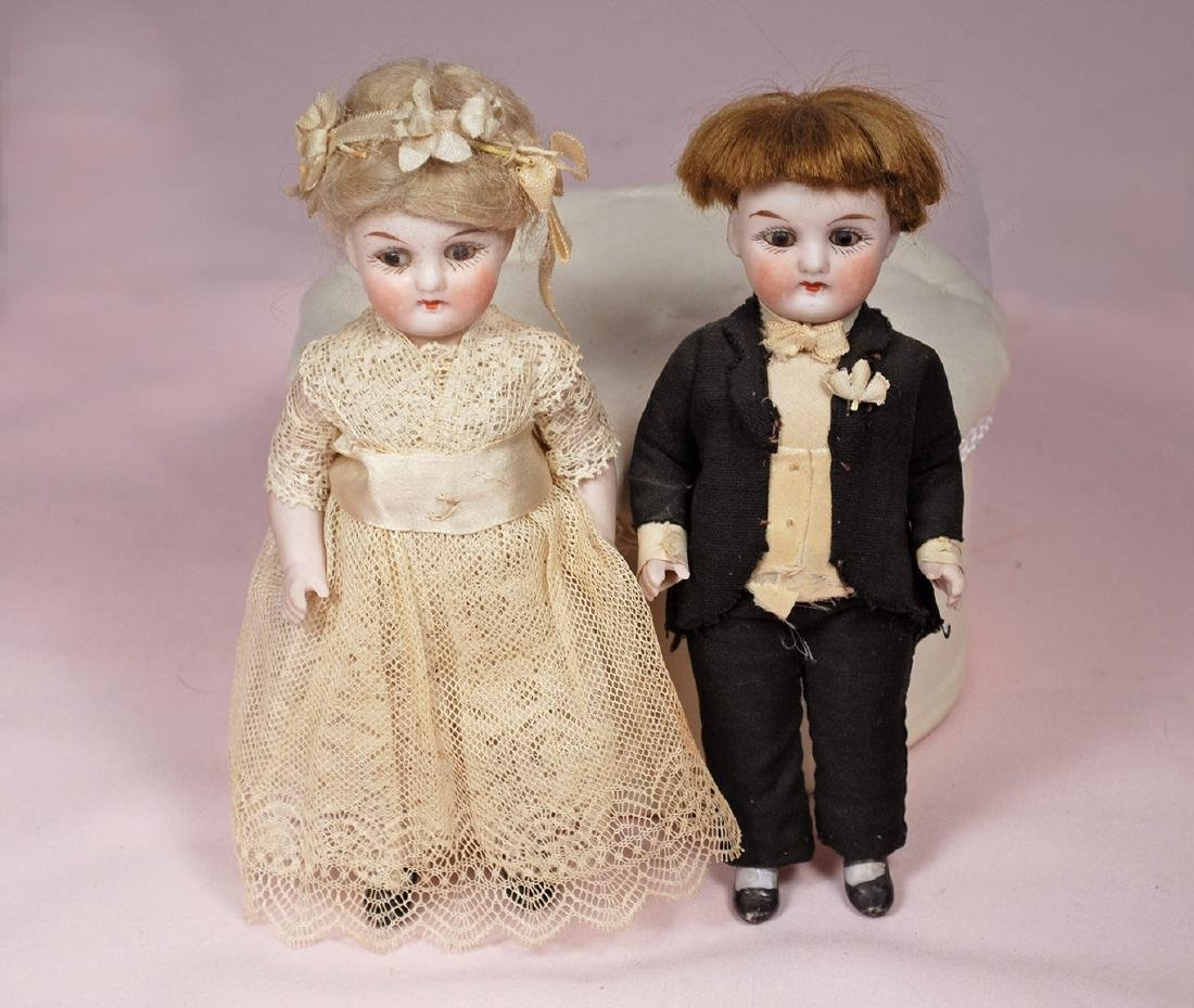 92. GERMAN ALL-BISQUE DOLLS AS BRIDE AND GROOM. Marks: