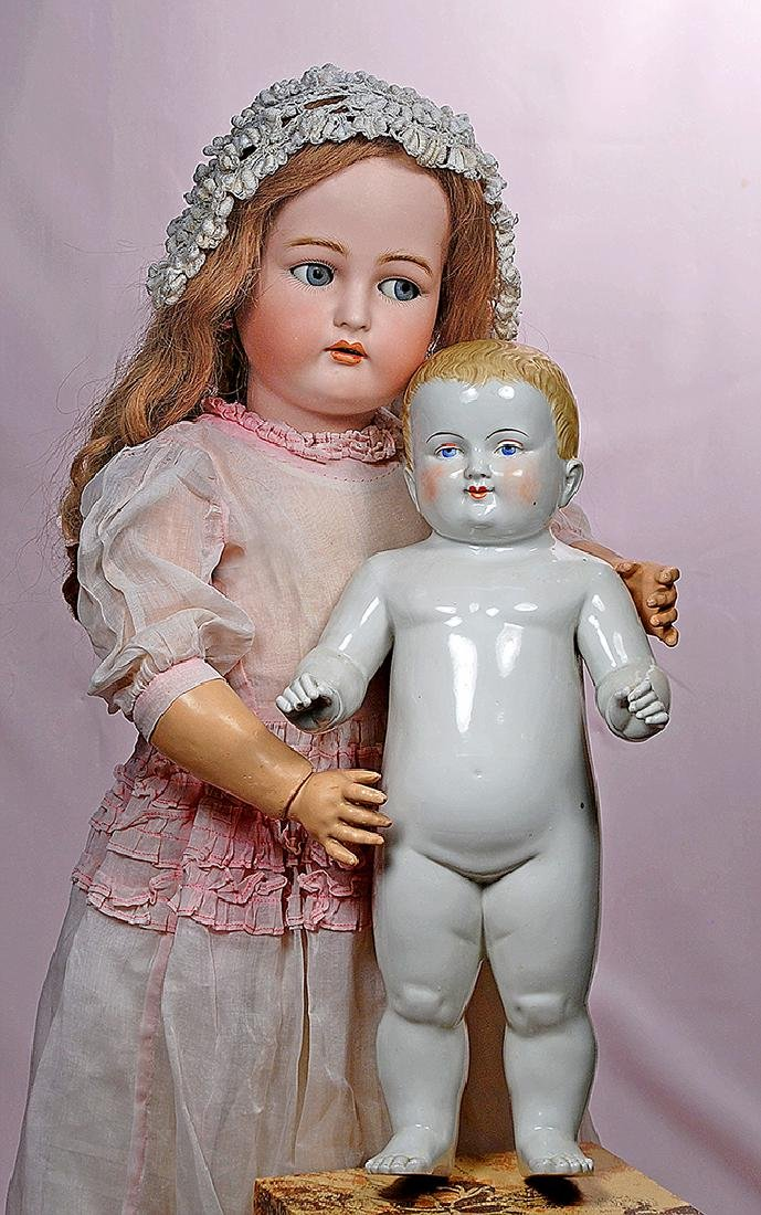 98. FLIRTY-EYED GERMAN BISQUE DOLL BY KAMMER &