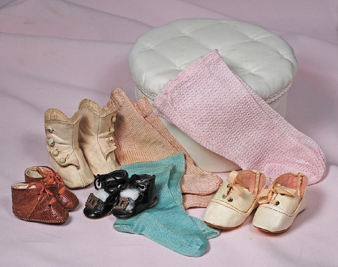 "105. GROUP OF DOLL SHOES AND SOCKS. Includes: 2 ¾"" pair"