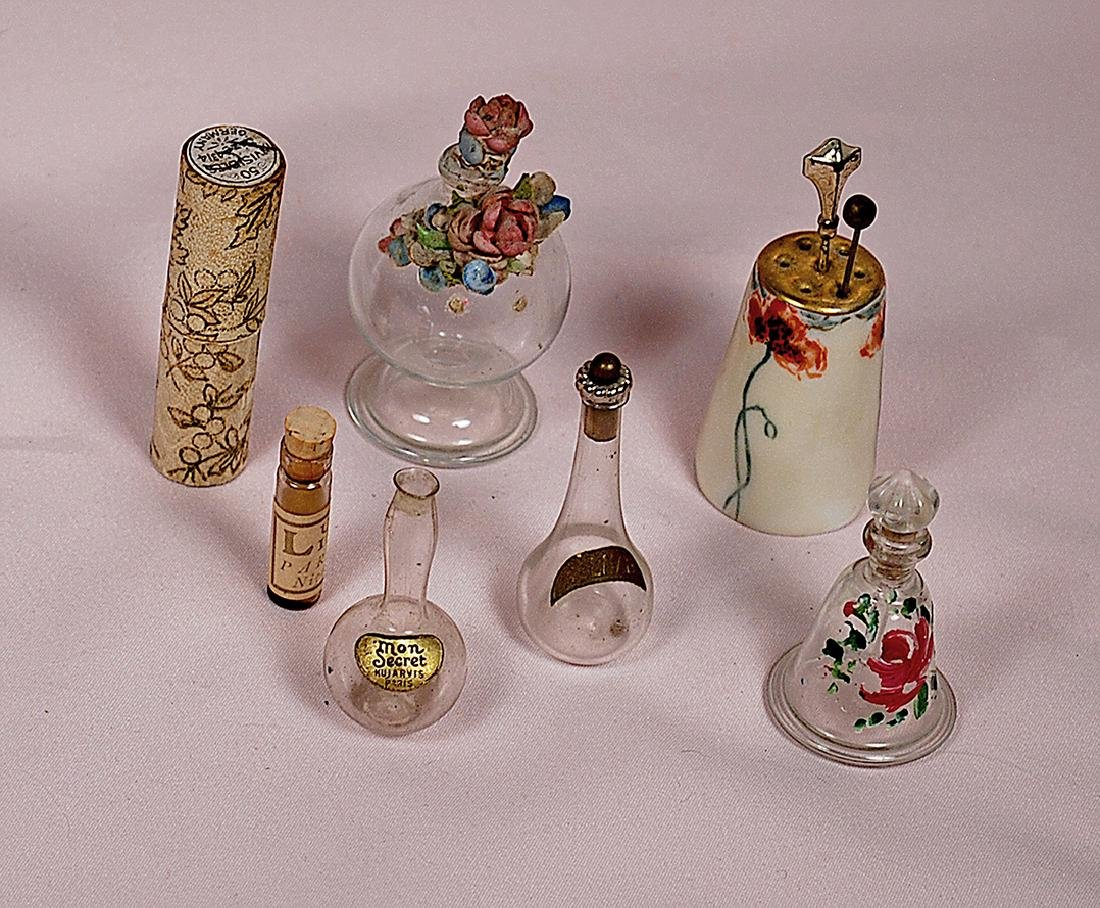111. MINIATURE PERFUME BOTTLES, HAT PIN HOLDER AND